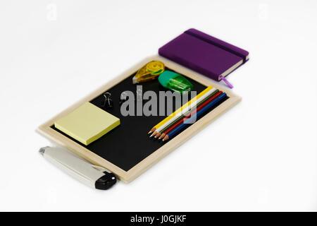 Notebook, black board, paper knife, highlighter, color pencil, correction pen, binder clip, sharpener, memory note - Stock Photo