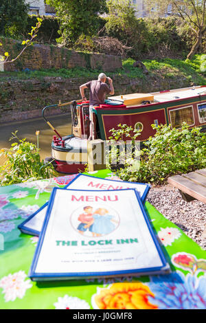 Lock Inn café menus with views of narrow boats passing by on the Kennet and Avon canal at Bradford on Avon, Wiltshire - Stock Photo