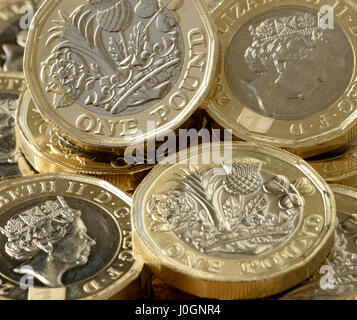 New £1 coin is 12 sided and is the most secure coin in the world - British new £1 coin is bimetallic with latent - Stock Photo
