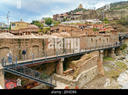 Tbilisi, Georgia - September 24, 2016: Abanotubani district in the Old Town of Tbilisi. It is district with public - Stock Photo