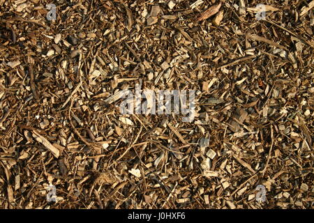Wood chippings or mulch as a background - Stock Photo