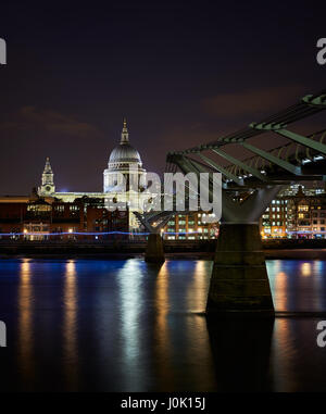 St. Paul's Cathedral, with its famous dome, is the most famous church in London. On the photo is also  the Millenium - Stock Photo