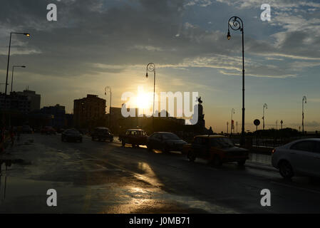 Traffic on the Malecon at sunset in Cuba - Stock Photo