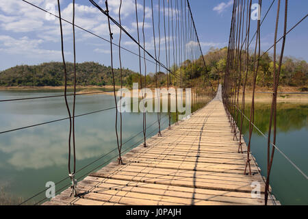 Famous rope wooden bridge in Kaeng Krachan National Park, Phetchaburi, Thailand - Stock Photo