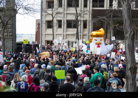 Seattle, Washington, USA. 15th April, 2017. 'Chicken Don' statue appears at the rally at the Henry M. Jackson Federal - Stock Photo