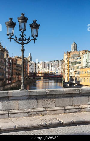 View of central Girona from Pont de Pedra bridge, which was built over the river Onyar in the 19th Century. - Stock Photo