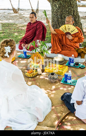 monks blessing buddhist wedding ceremony for western european couple in cambodia asia - Stock Photo