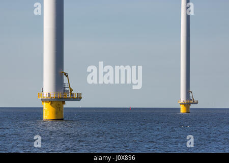 Foundation of big wind turbines standing in the sea - Stock Photo