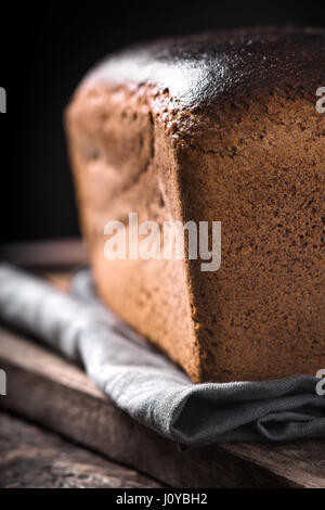 Rye bread on the wooden board vertical - Stock Photo