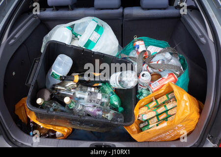 bottles and tins in the boot of car ready to take for recycling. UK - Stock Photo