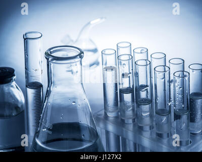 Different laboratory beakers and glassware. Monochrome. - Stock Photo