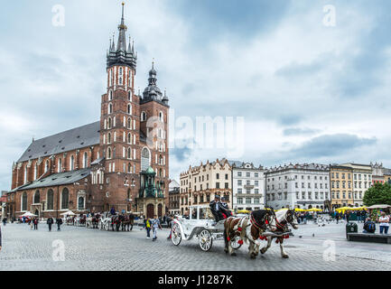 Saint Mary Basilica and Main Square in Krakow. - Stock Photo