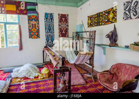 Loom in workshop for silk fabric production in traditional Uzbek patterns, Uzbekistan - Stock Photo