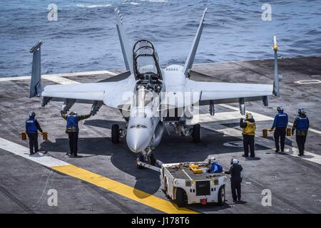 Uss Theodore Roosevelt, United States Of America. 17th Apr, 2017. U.S. Navy sailors park an F/A-18F Super Hornet - Stock Photo