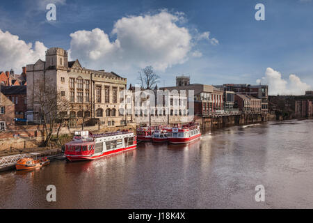 A winter view along the River Ouse, York, North Yorkshire, with pleasure boats of the YorkBoat line and traditional - Stock Photo