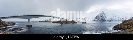 The Hamnoy's bridge over the sea in Lofoten islands of Norway in winter time, panoramic image - Stock Photo