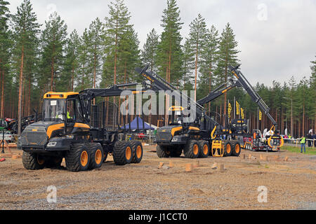 JAMSA, FINLAND - SEPTEMBER 1, 2016: Two unnamed professionals compete on Ponsse forwarders in the National Forest - Stock Photo
