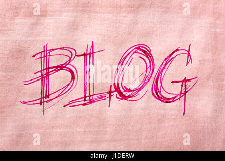 The word Blog handwriting in sketch like style by use of a nib pen and brown painted paper - Stock Photo