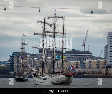Tall sailing ships at the Greenwich Peninsular on the River Thames near the O2 Arena at North Greenwich in London - Stock Photo