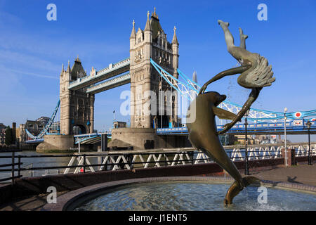 Girl with a Dolphin Sculpture by David Wynne and Tower Bridge, London, England, United Kingdom - Stock Photo