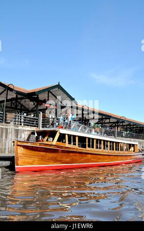 TIGRE, BUENOS AIRES, ARGENTINA - NOVEMBER 2016: Closeup of a typical wooden old water taxi motorboat in the port - Stock Photo