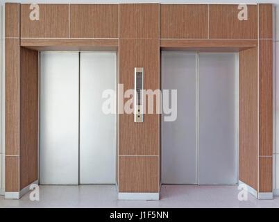 Elevator door or steel door inside office building. - Stock Photo