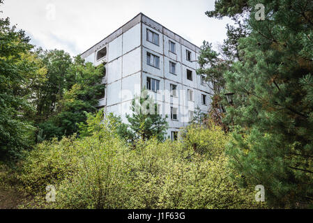 Block of flats in Pripyat ghost city of Chernobyl Nuclear Power Plant Zone of Alienation around nuclear reactor - Stock Photo
