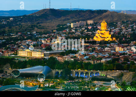 Night view of center Tbilisi city. Cityscape with evening illumination and famous landmarks from Sololaki hill. - Stock Photo