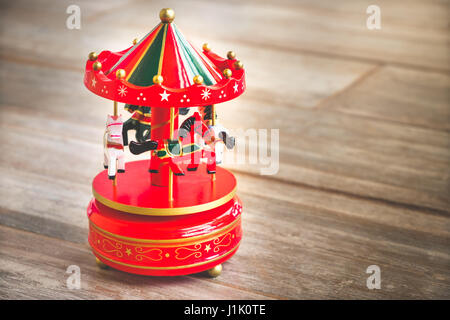 merry go round red carousel carillon horses toy vintage old - Stock Photo