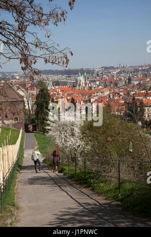 People walking along the path leading from near to the monastery in Prague down to the old town with a view over - Stock Photo