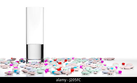 3D illustration of a glass of water and many pills and tablets around it. Concept of overmedication over white background. - Stock Photo