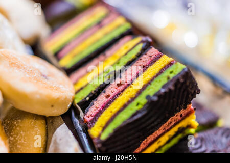 Macro closeup of colorful cookie or cake bars covered in chocolate - Stock Photo