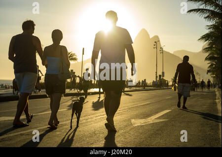 RIO DE JANEIRO - FEBRUARY 12, 2017: Brazilians enjoy a sunset afternoon on the car-free beachfront street in Ipanema. - Stock Photo