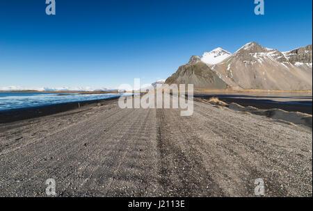 Iceland, Dirt road in Vestrahorn and Stokksnes peninsula - Stock Photo