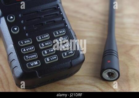 Walkie Talkie Hand Held Keypad and Antenna - Stock Photo