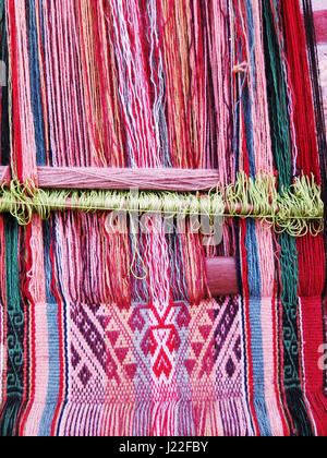 Natural dyed wool yarn in the peruvian Andes at Cuzco Peru - Stock Photo
