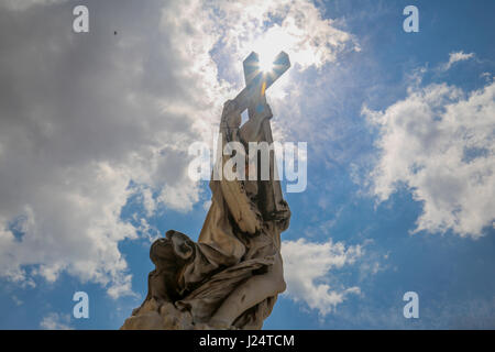 A statue  with cross by Bernini on Saint Angel's Bridge, Rome, Italy - Stock Photo