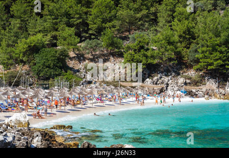 Greece, Thassos - September 21: Beautiful Marble beach also known as Saliara beach, tourists enjoying a nice summer - Stock Photo