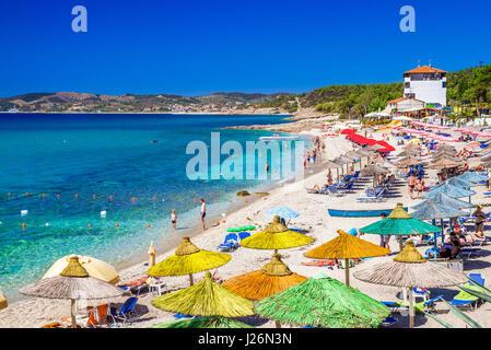 Greece, Thassos - September 19: Beautiful Pefkari beach near Potos, tourists enjoying a nice summer day at the beach - Stock Photo
