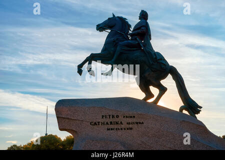 Equestrian statue of Peter the Great (bronze horseman), Saint Petersburg, Russia. Silhouette against dramatic morning - Stock Photo