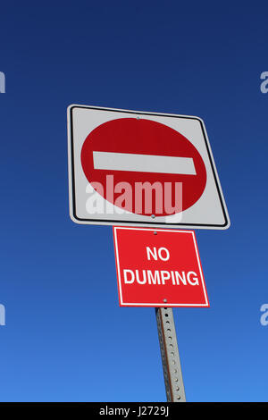 No Entry or Dumping Sign Against Blue Sky. - Stock Photo