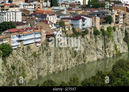 TBILISI, GEORGIA-SEP 25, 2016: Buildings above Kura river in the city center aerial view from Narikala Fortress. - Stock Photo