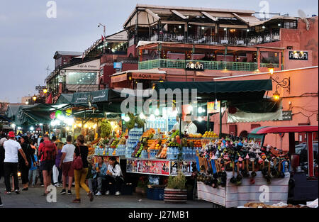 Stands of traders offering fresh juice can be seen during the evening on the market square Jemaa el-Fnaa in Marrakesh, - Stock Photo