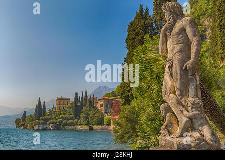 View of Varenna village from the botanic gardens of Villa Monastero, Varenna on the eastern shore of Lake Como Italy - Stock Photo