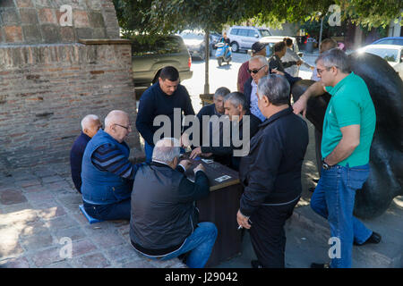 TBILISI, GEORGIA-SEP 25, 2016: Georgian men playing cards for money in the centre of old town. - Stock Photo