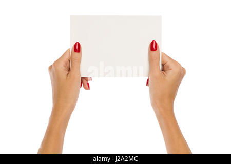 Close up of two woman's hands with red nails holding blank white paper sheet. Studio shot isolated on white. - Stock Photo