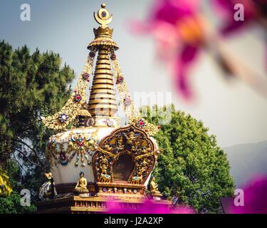Stupa at Kopan Monastery temple garden in Kathmandu Nepal. - Stock Photo