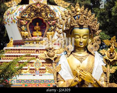 Close up detail of statues and stupa at Kopan Monastery temple garden in Kathmandu Nepal. - Stock Photo