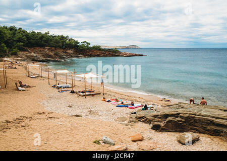 Greece, Thassos - September 20: Beautiful beach near Potos, tourists enjoying a nice summer day at the beach in - Stock Photo