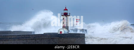Lighthouse of Porto during storm, Portugal - Stock Photo